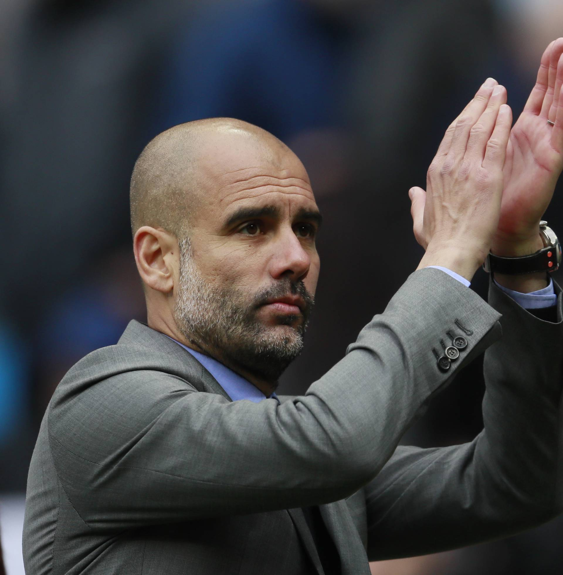 Manchester City manager Pep Guardiola applauds fans after the match