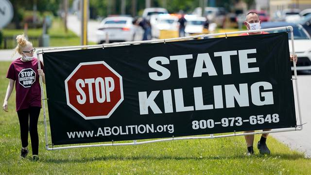 FILE PHOTO: Protesters against the death penalty in Terre Haute, Indiana