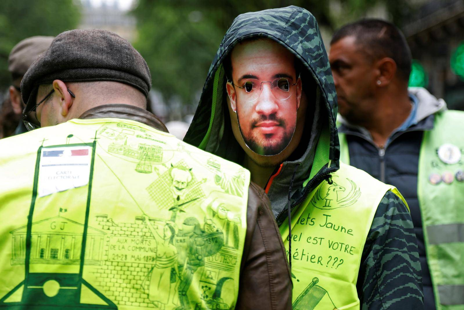 Protesters wearing yellow vests attend a demonstration in Paris