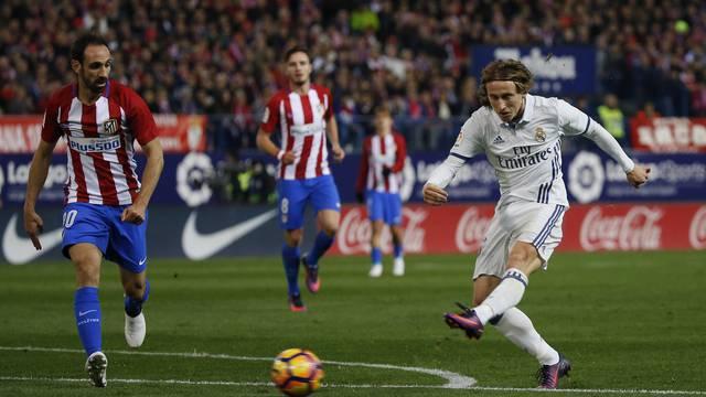 Real Madrid's Luka Modric shoots at goal