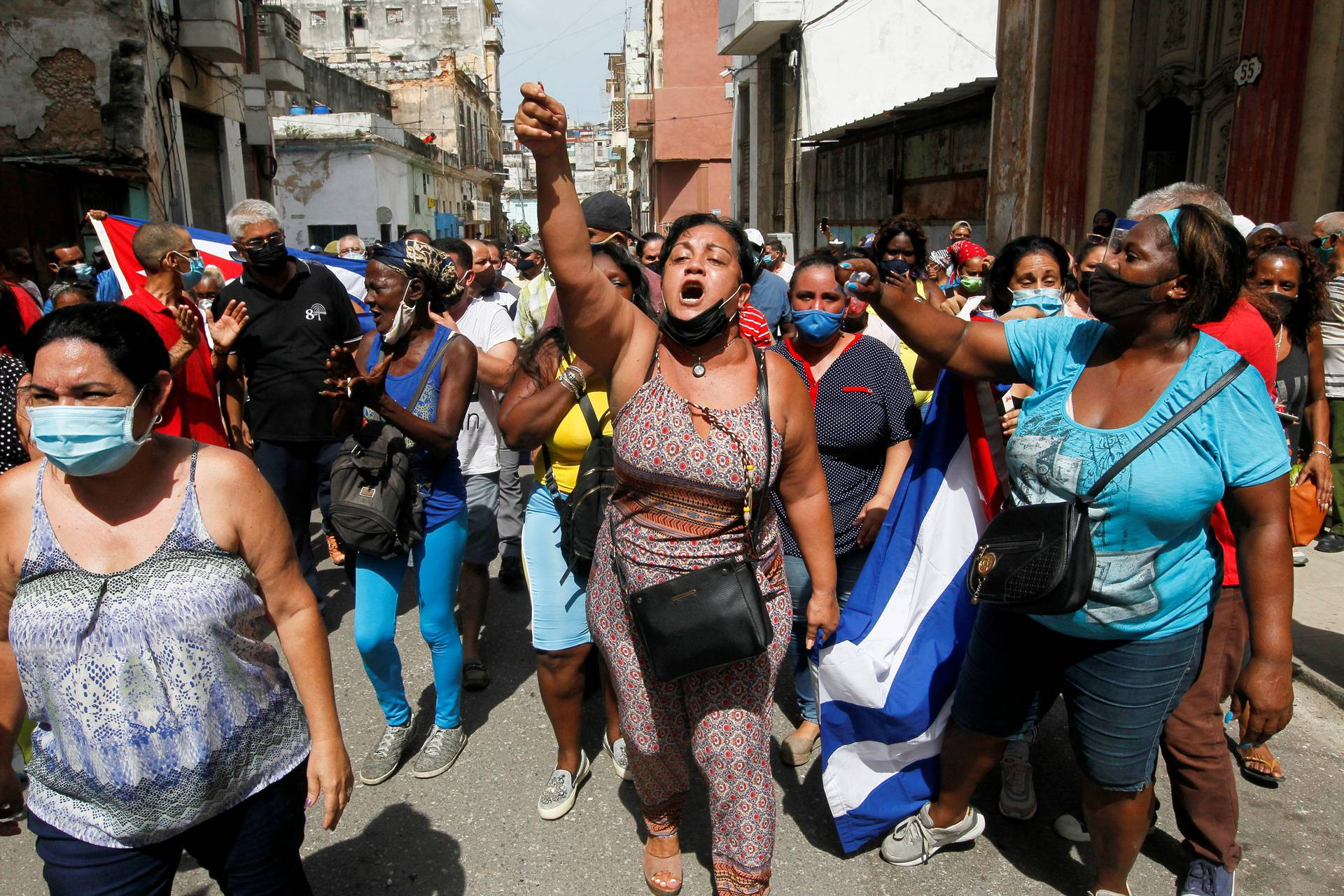 Government supporters react during protests against and in support of the government, in Havana