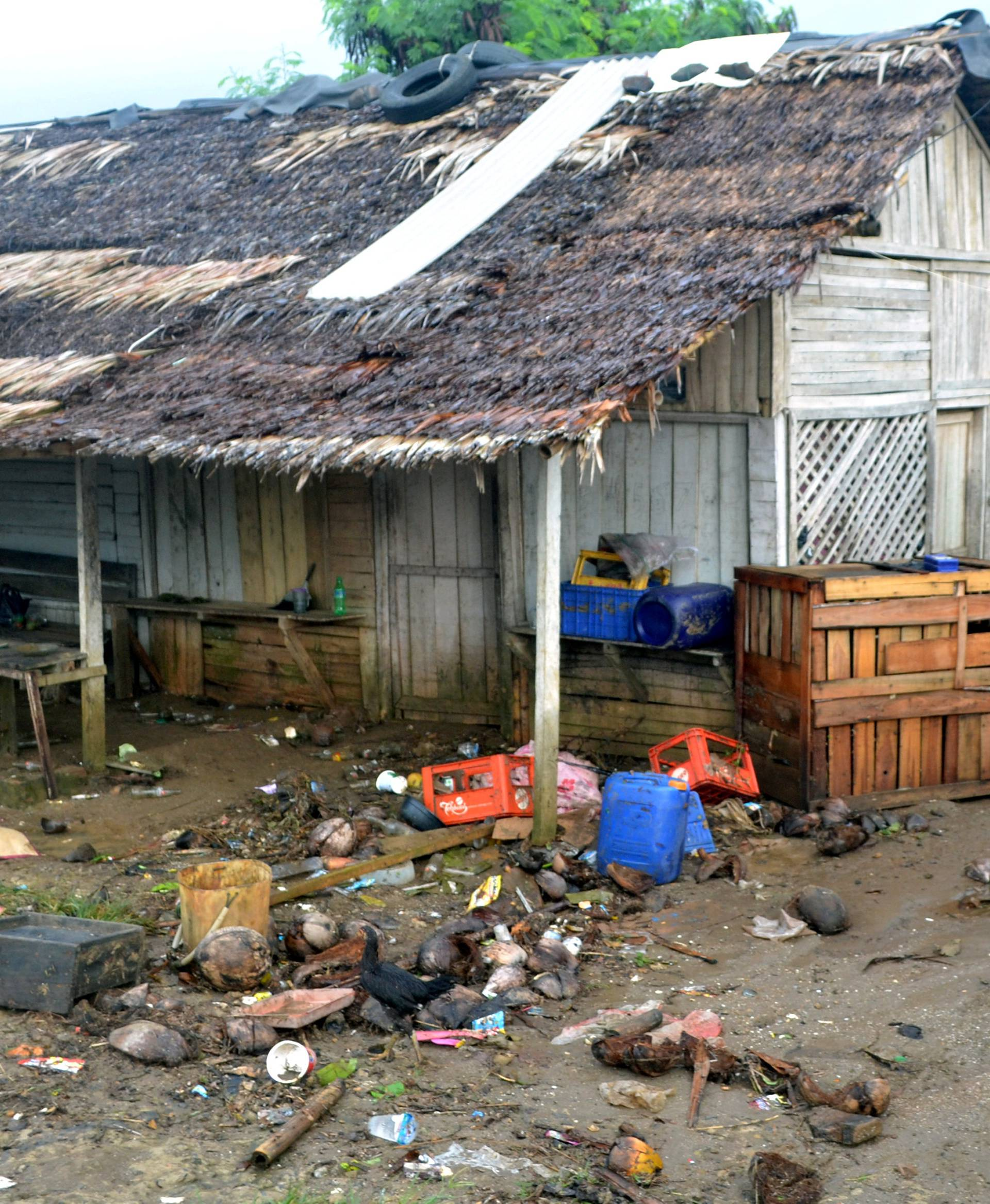 A local walks near her damaged house hit by tsunami at Tanjung Lesung district in Pandeglang, Banten province