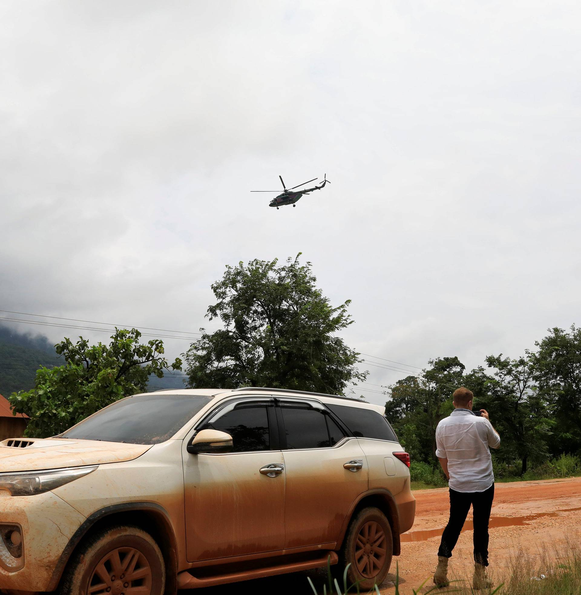 A military helicopter flies near flooded areas after the Xepian-Xe Nam Noy hydropower dam collapsed in Attapeu province