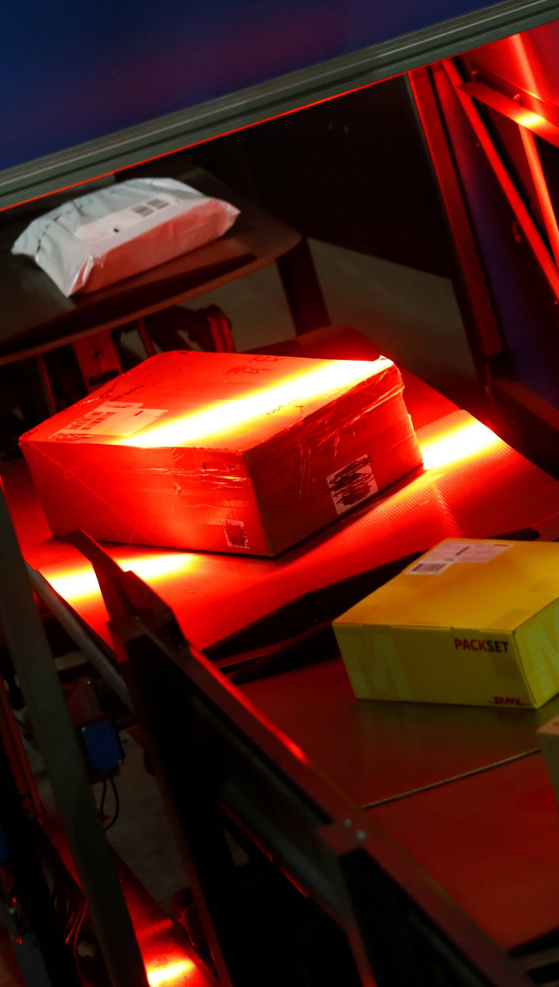 Parcels are scanned at a distribution centre of German postal and logistics group Deutsche Post DHL in Rodgau