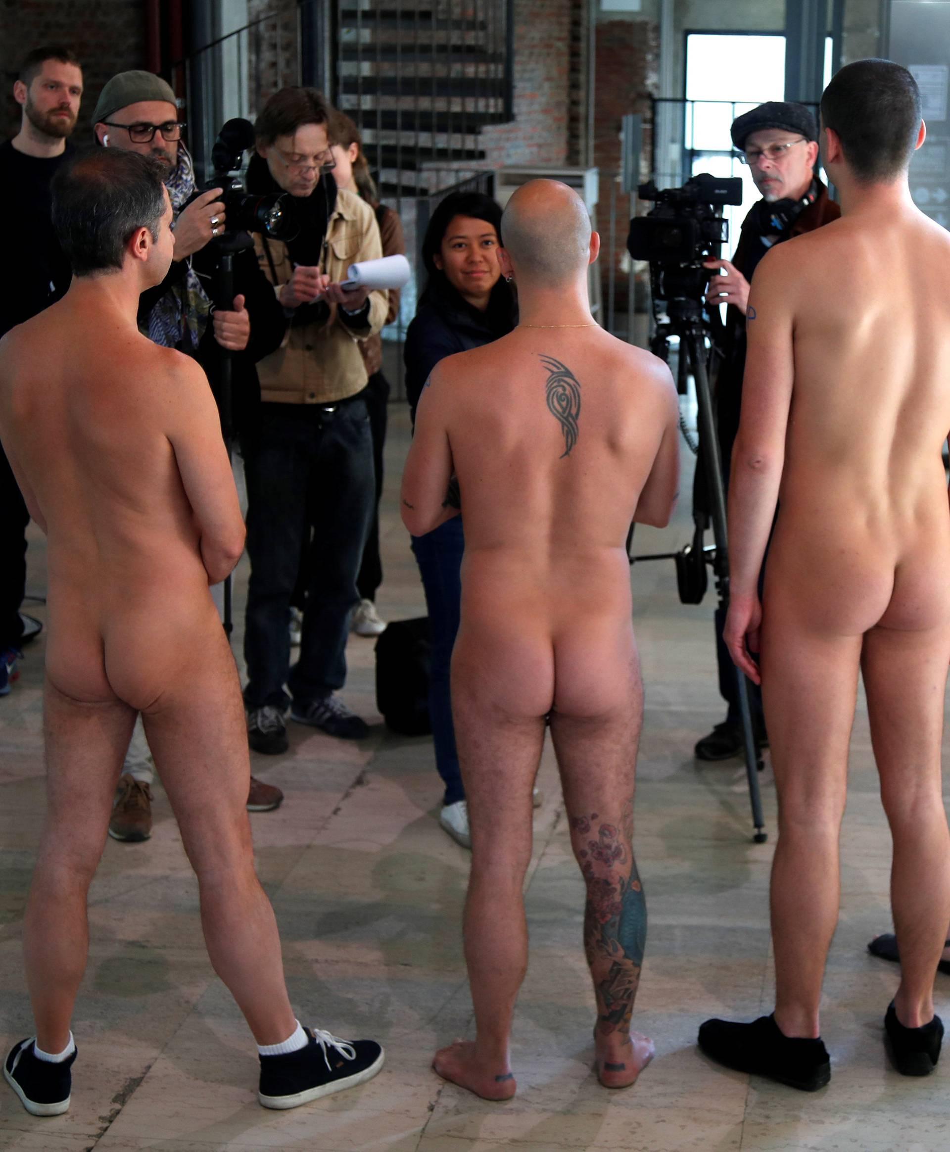 Members of the ANC (Association des Naturistes de Paris) attend a news conference before a nude visit of the Palais de Tokyo contemporary art centre in Paris