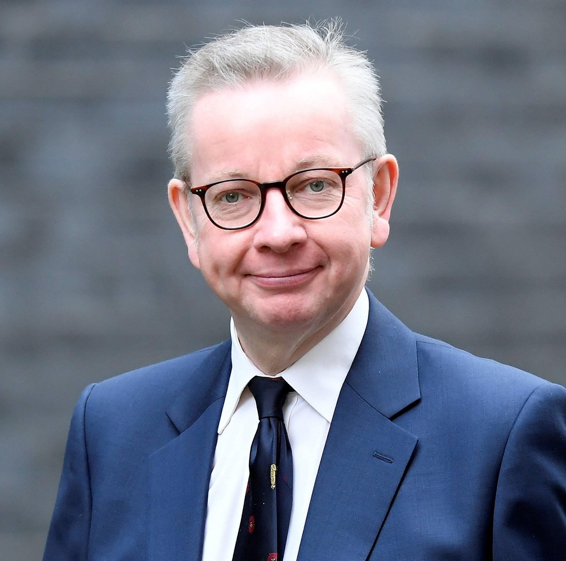FILE PHOTO: Michael Gove arrives at Downing Street in London