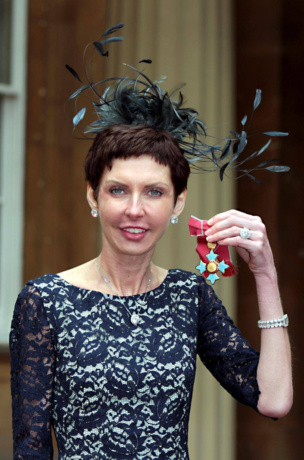 FILE PHOTO: bet365 Chief Executive Denise Coates poses with her CBE medal after being knighted by Britain's Prince Charles at Buckingham Palace in London