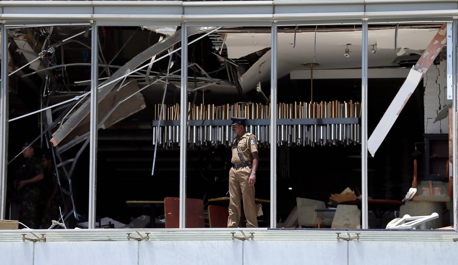 A police officer inspects the explosion area at Shangri-La hotel in Colombo