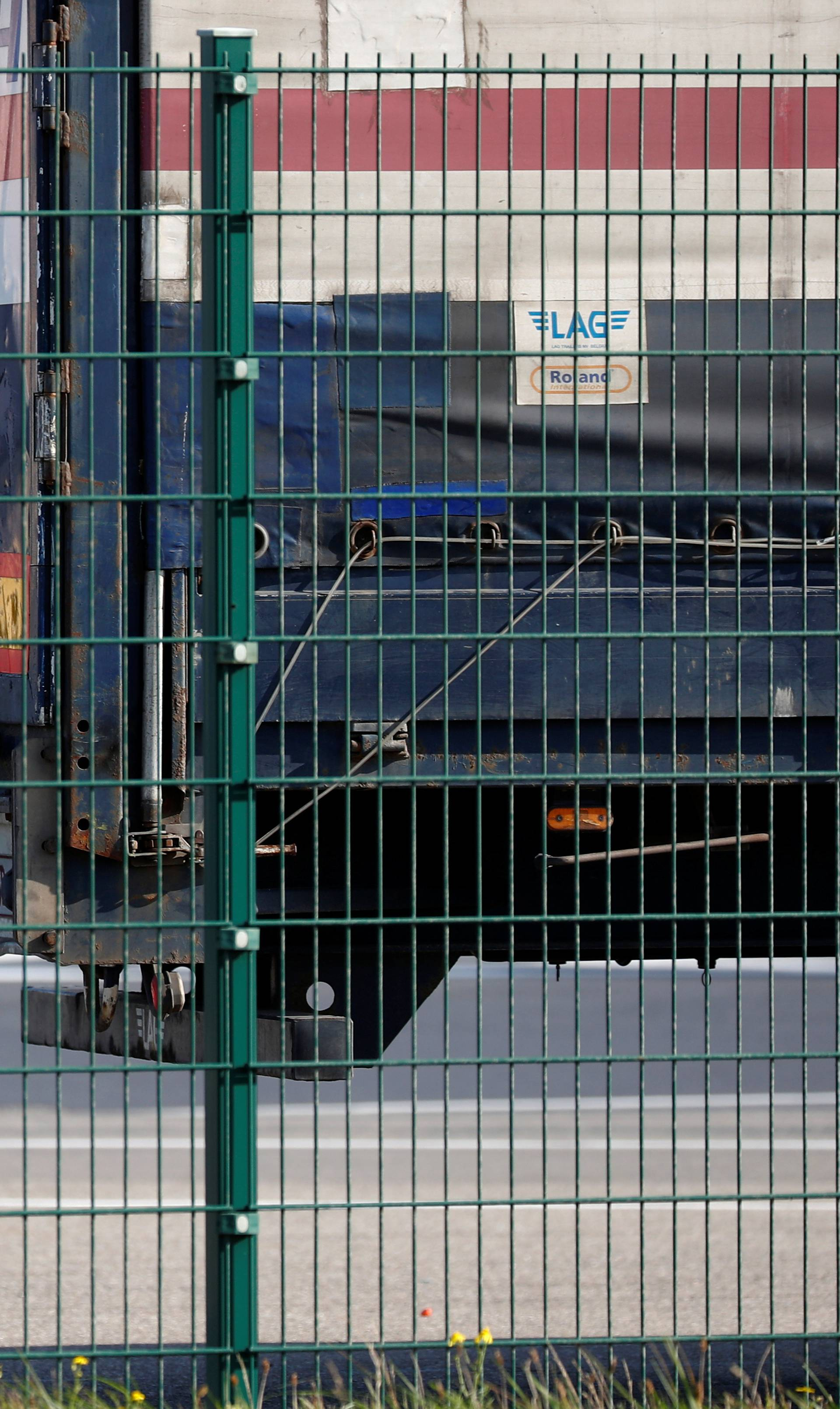 A truck driver is seen at the port of Zeebrugge after British police found bodies inside a lorry container in Grays, Essex, in Zeebrugge
