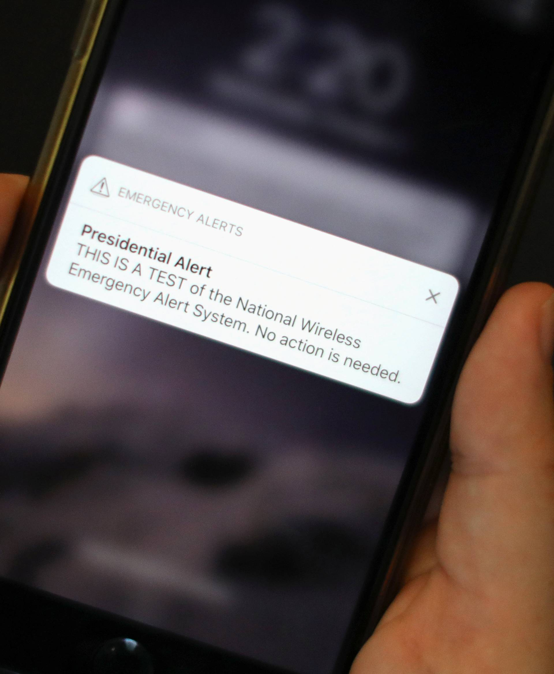 A test text message of the Presidential Alert National Wireless Emergency Alert System is seen on a mobile phone in New York