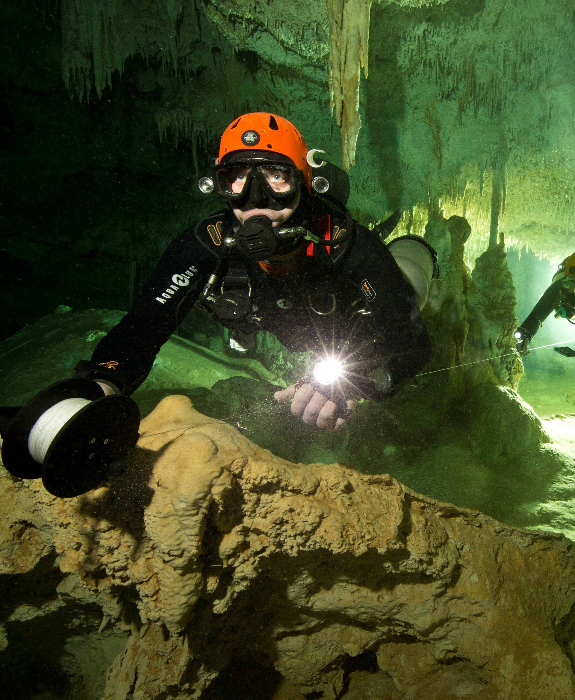 Scuba diver measures the length of Sac Aktun underwater cave system as part of the Gran Acuifero Maya Project near Tulum