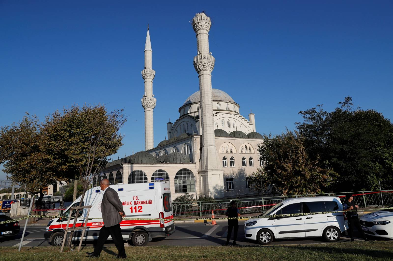 Police cars and an ambulance are parked in front of a mosque, where one of its minarets collapsed after an earthquake, in Istanbul