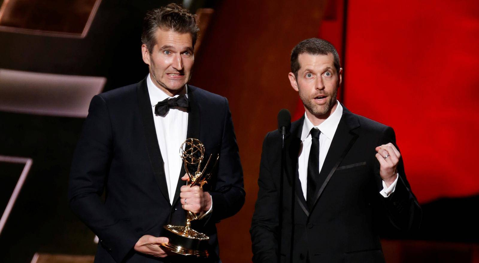 """FILE PHOTO: Benioff and Weiss accept the award for Outstanding Writing For A Drama Series for HBO's """"Game of Thrones"""" at the 67th Primetime Emmy Awards in Los Angeles"""