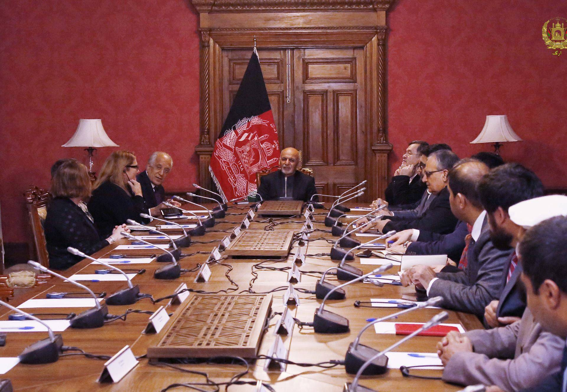 Afghanistan's President Ashraf Ghani talks with the U.S. special envoy for peace in Afghanistan, Zalmay Khalilzad, during a meeting in Kabul