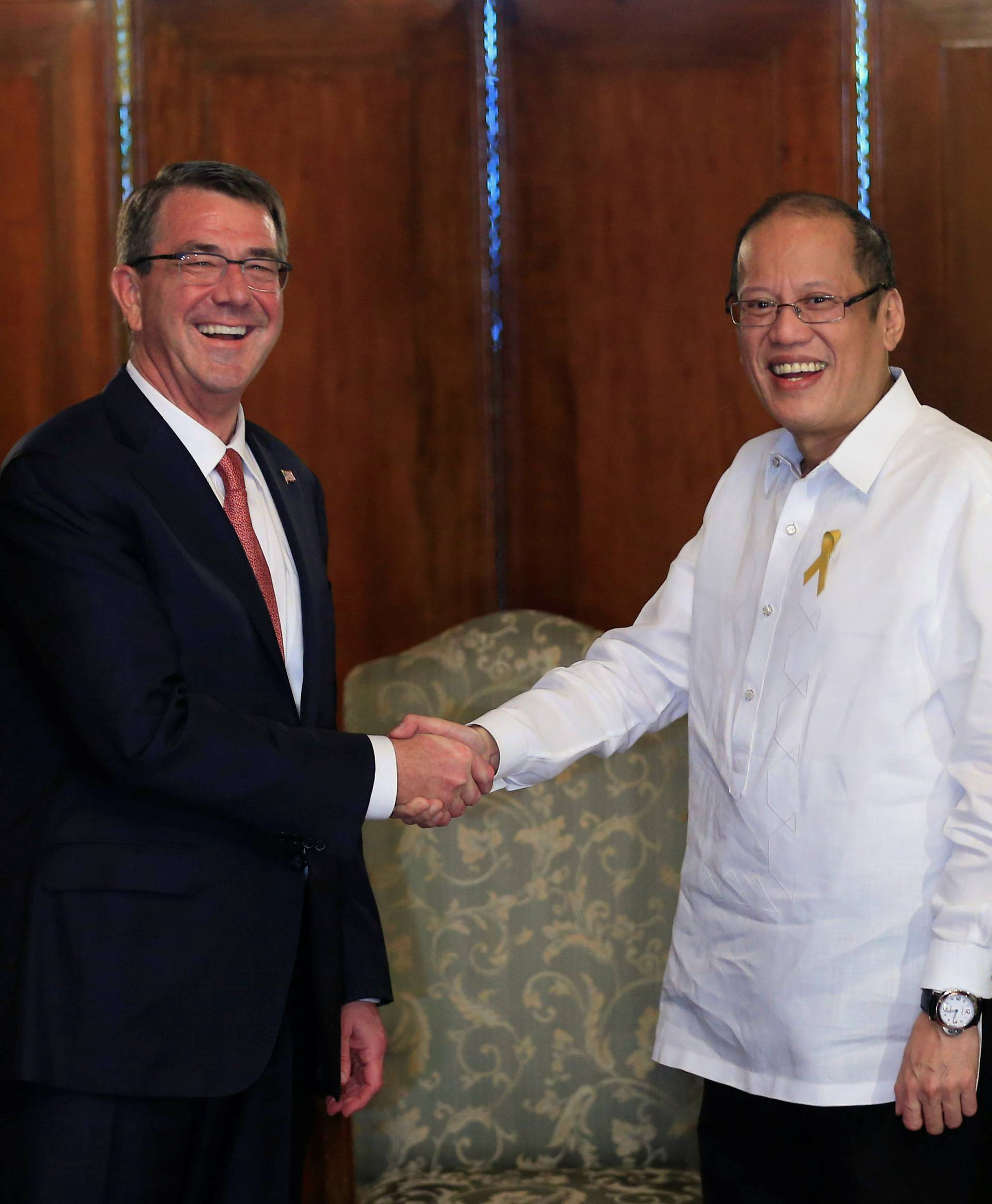 President of the Philippines Benigno Aquino greets visiting U.S. Defense Secretary Ash Carter at the presidential palace in Manila