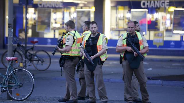 Police officers stand guard outside the main train station  following shooting rampage at shopping mall in Munich