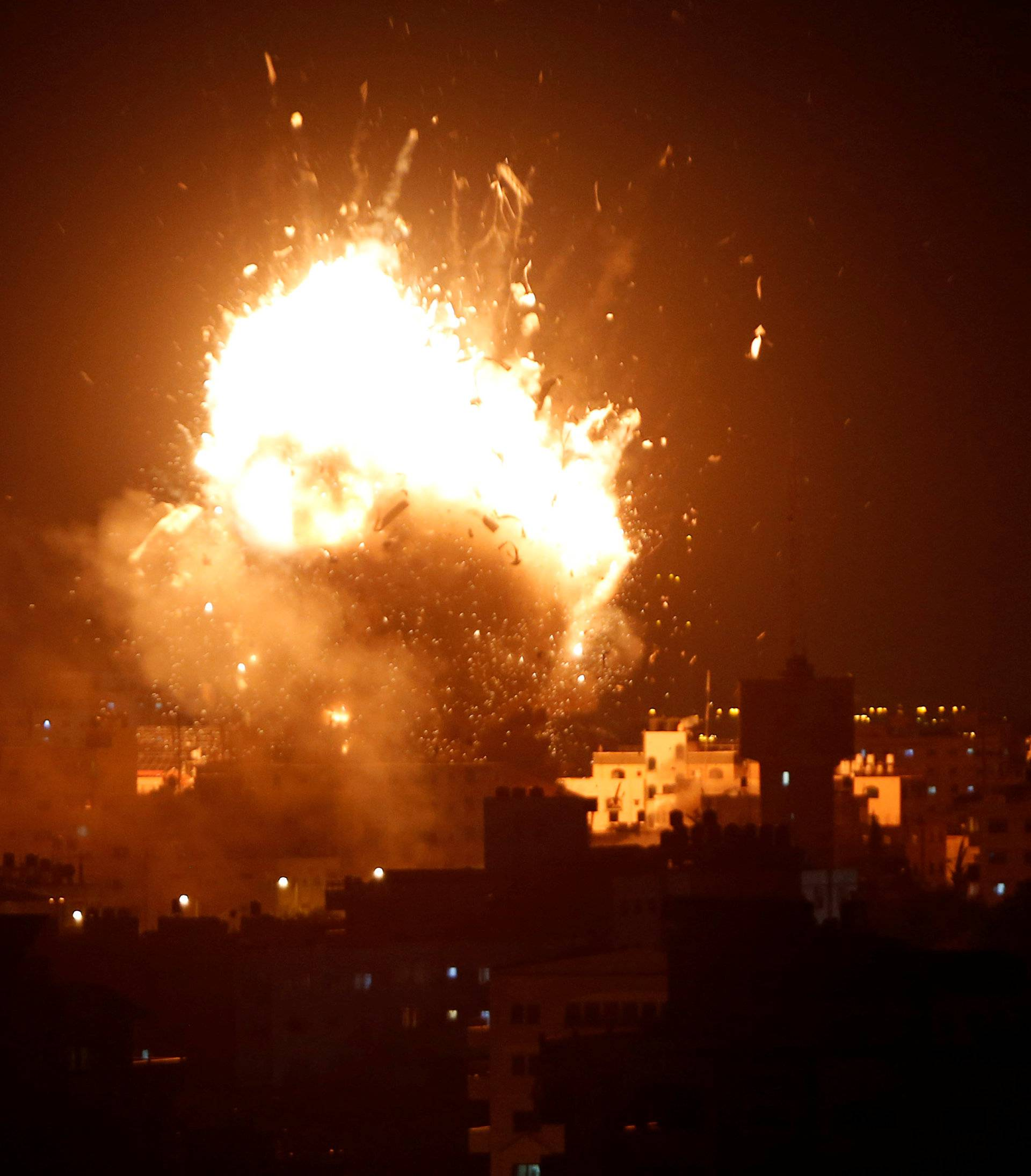 Explosion is seen during an Israeli air strike on Hamas's television station, in Gaza City