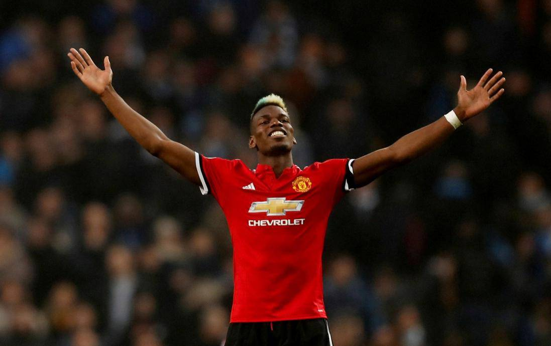 FILE PHOTO: Manchester United midfielder Paul Pogba celebrates after his match-winning display against rivals Manchester City at the Etihad Stadium
