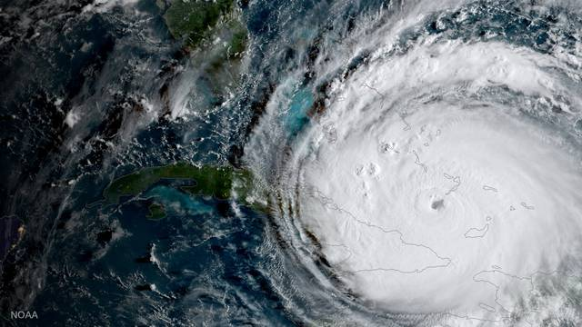 NOAA National Weather Service National Hurricane Center image of Hurricane Irma is driving toward Florida passing the eastern end of Cuba