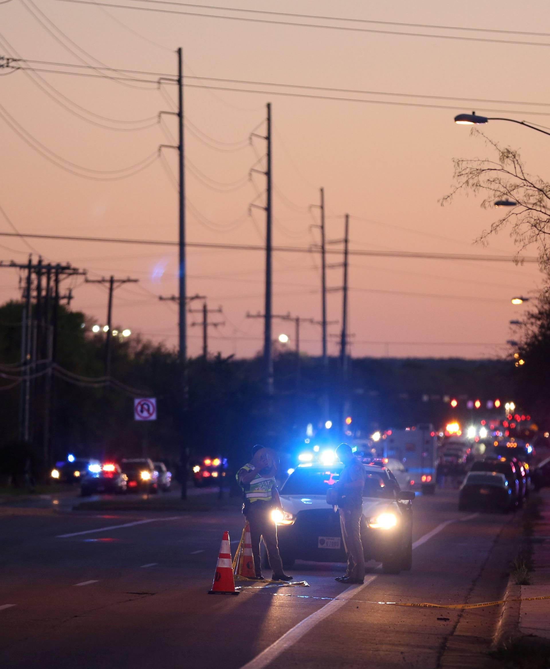 Law enforcement personnel investigate an incident  in Austin