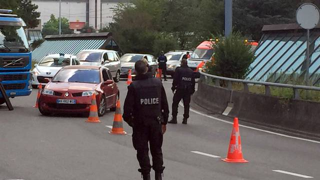 Swiss police check cars at entrance of the Cointrin airport in Geneva
