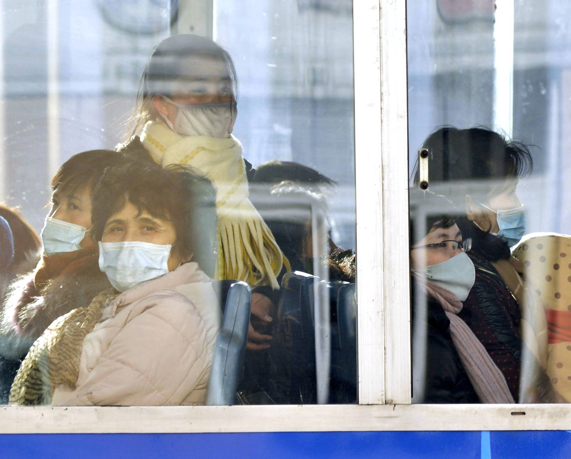 Passengers wear masks inside a trolley bus in Pyongyang