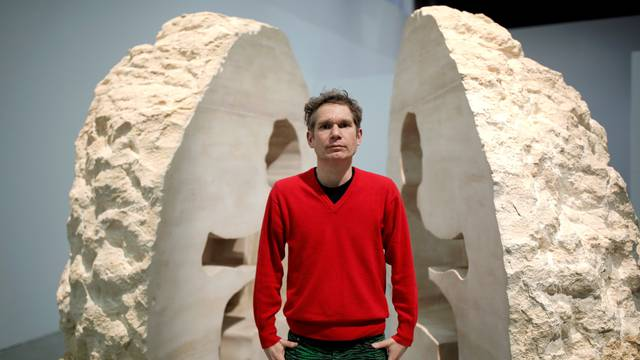 """French artist Abraham Poincheval poses in front of his artwork Pierre (""""Stone"""") in Paris"""