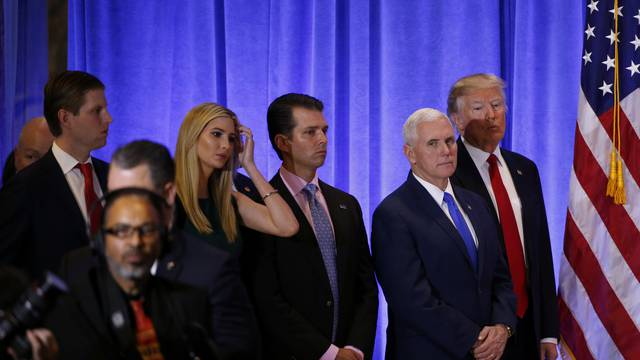 U.S. President-elect Donald Trump stands with Vice President-elect Mike Pence, his sons Donald Trump Jr. and Eric Trump, and daughter Ivanka, during a news conference in the lobby of Trump Tower in Manhattan, New York City