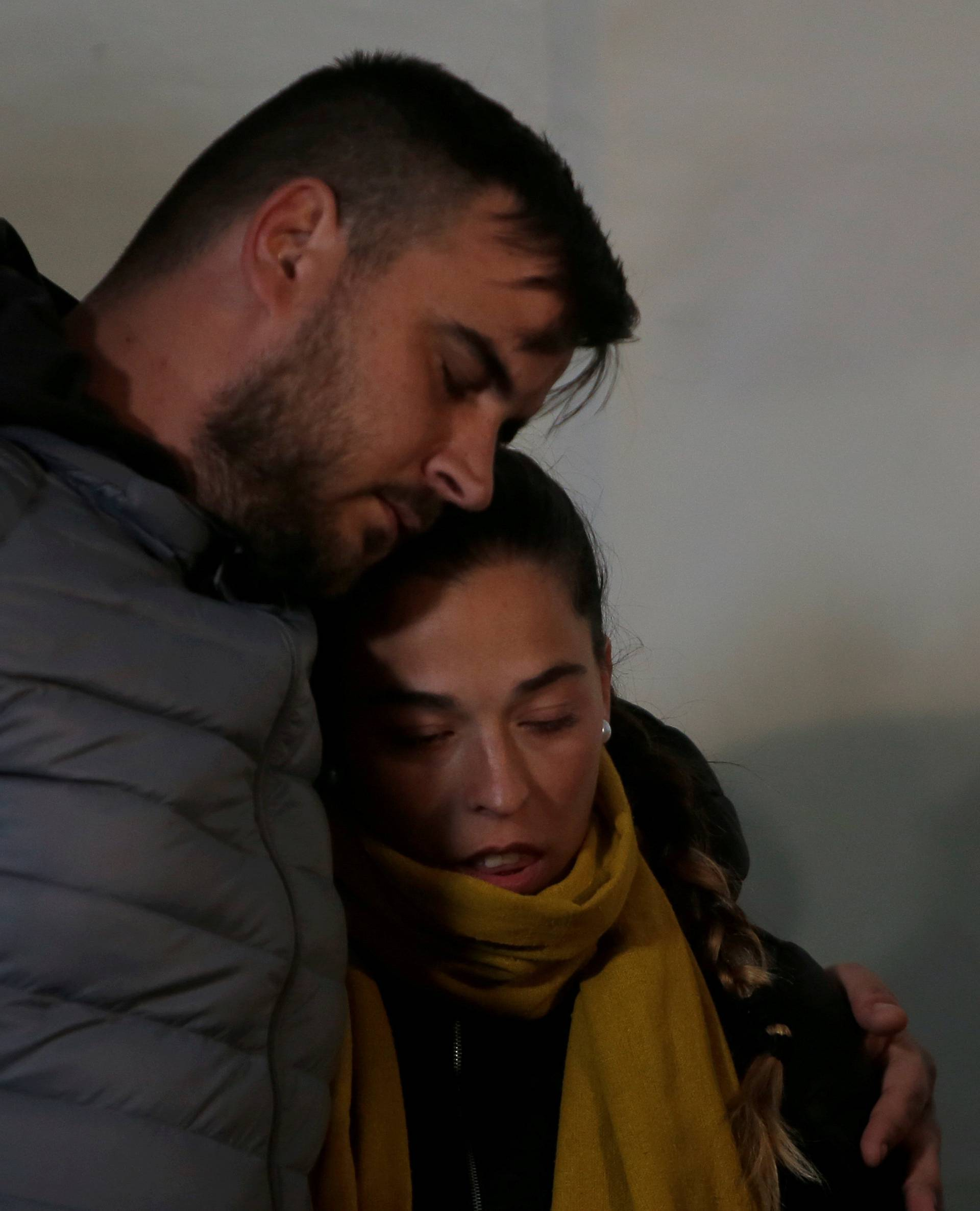 FILE PHOTO: FILE PHOTO: Julen's parents embrace each other during a vigil as a miner rescuer team descends into a drilled well at the area where Julen, a Spanish two-year-old boy, fell into a deep well, in Totalan