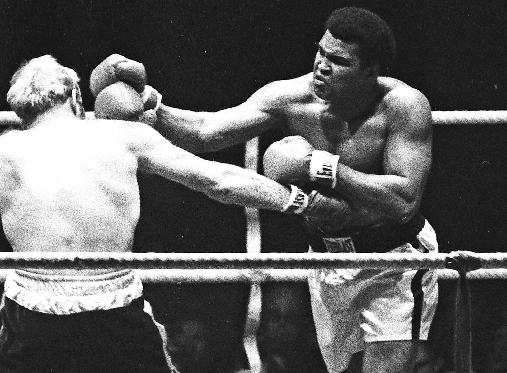 Muhammad Ali punches Richard Dunn while fighting for the WBC & WBA Heavyweight Title in Munich