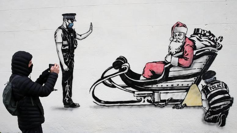 Novi prigodni grafit škotskog Banksyja: Restrikcije na putu smetaju čak i Djedu Božićnjaku