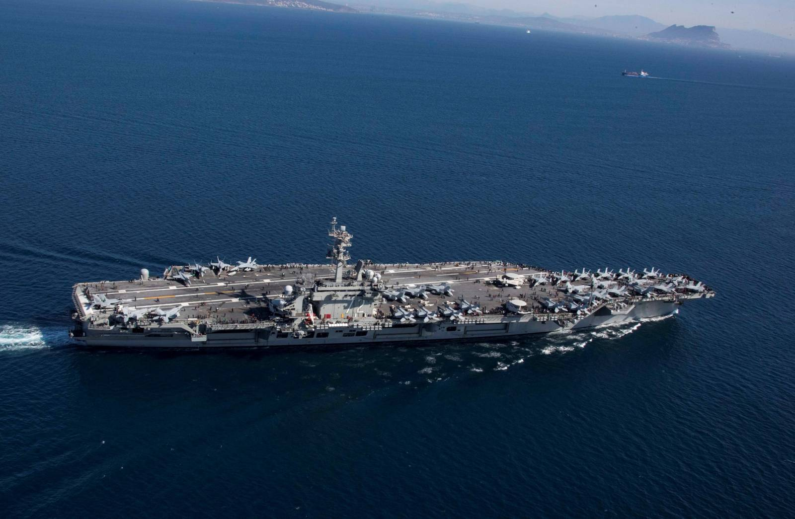 The Nimitz-class aircraft carrier USS Abraham Lincoln (CVN 72) transits the Strait of Gibraltar, entering the Mediterranean Sea