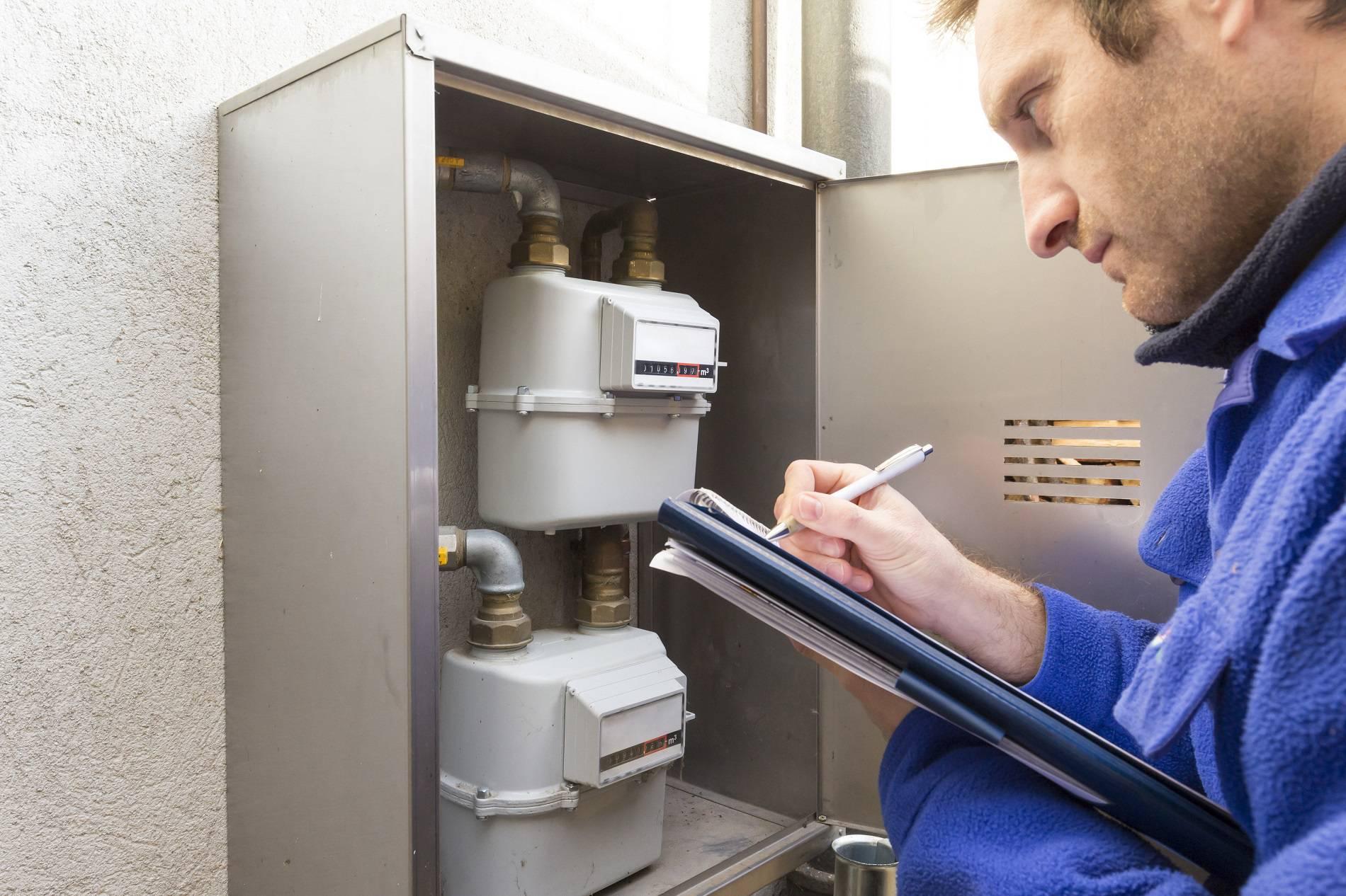 plumber at work making the consumption metering