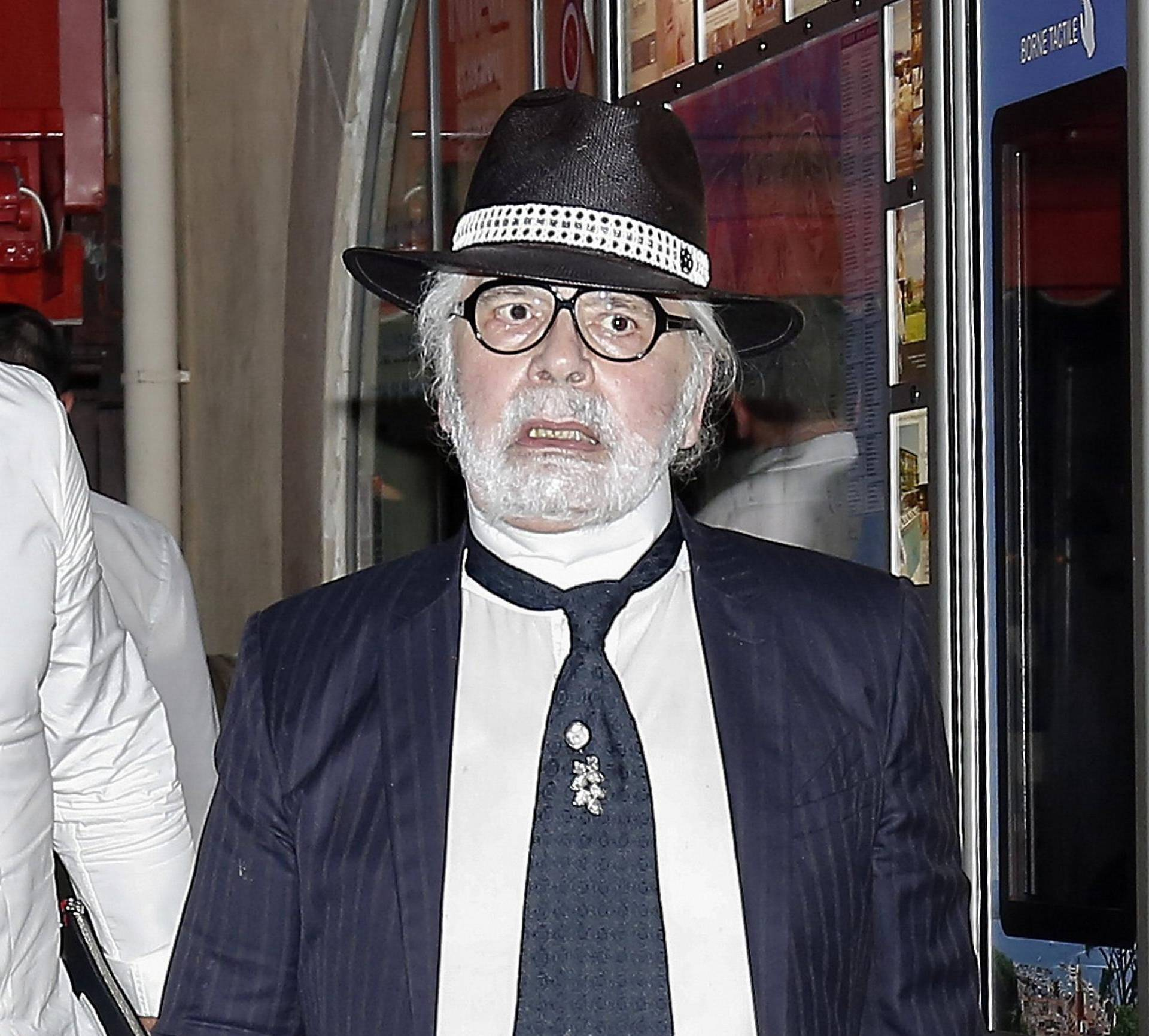 Karl Lagerfeld leaving Le Senequier in Saint Tropez