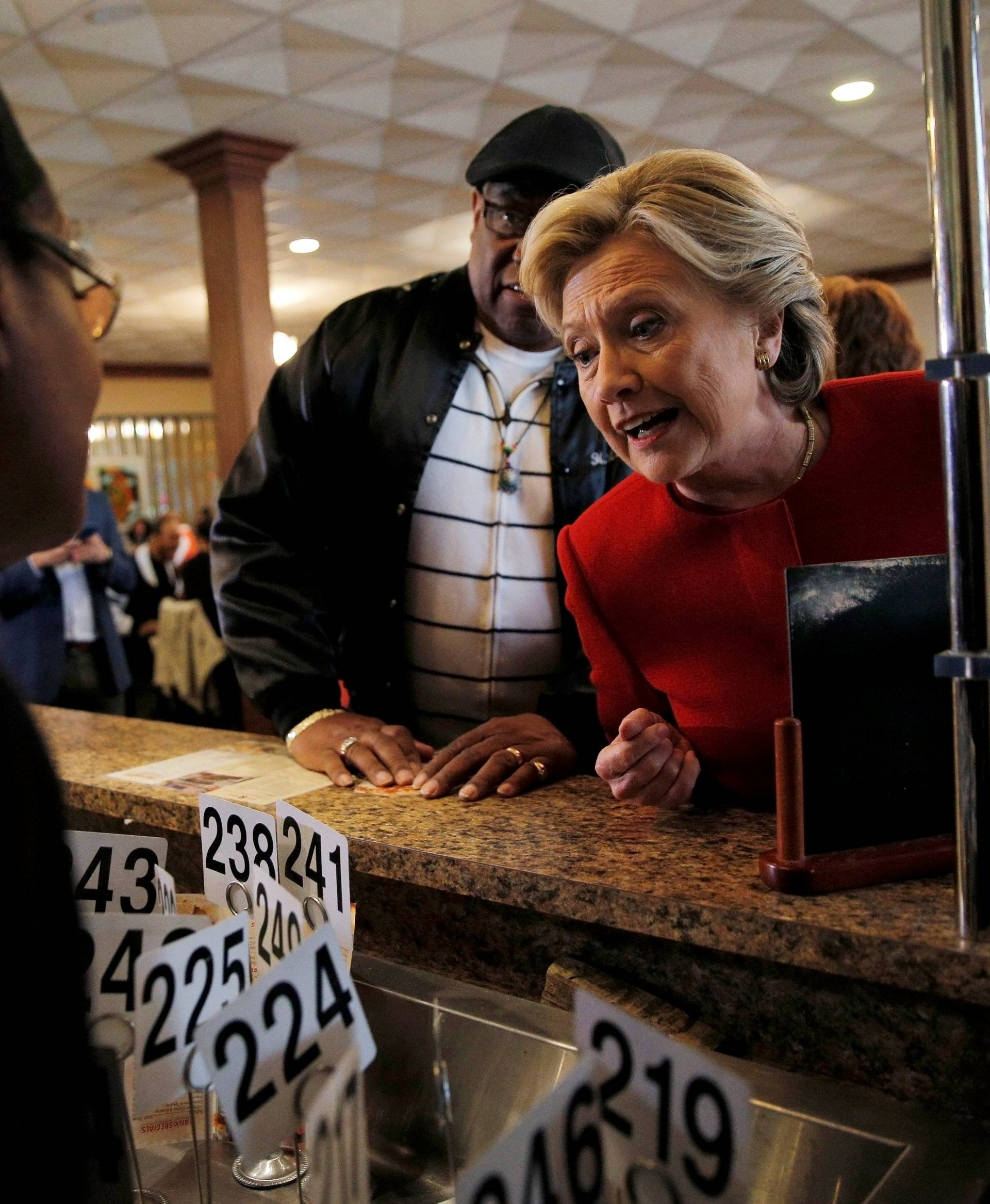 U.S. Democratic presidential nominee Hillary Clinton places an order at Angie's Soul Cafe in Cleveland
