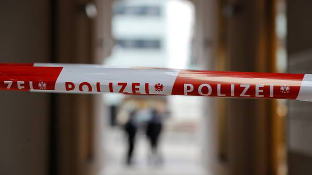 Police tape is seen at the site of shooting in a restaurant in downtown Vienna