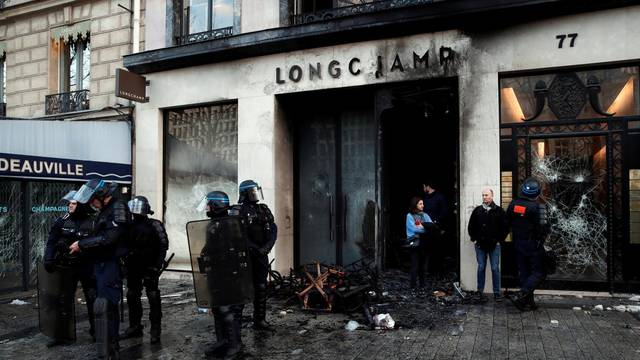"The damaged window of a Longchamp shop is pictured on the Champs-Elysees after a demonstration by the ""yellow vests"" movement in Paris"