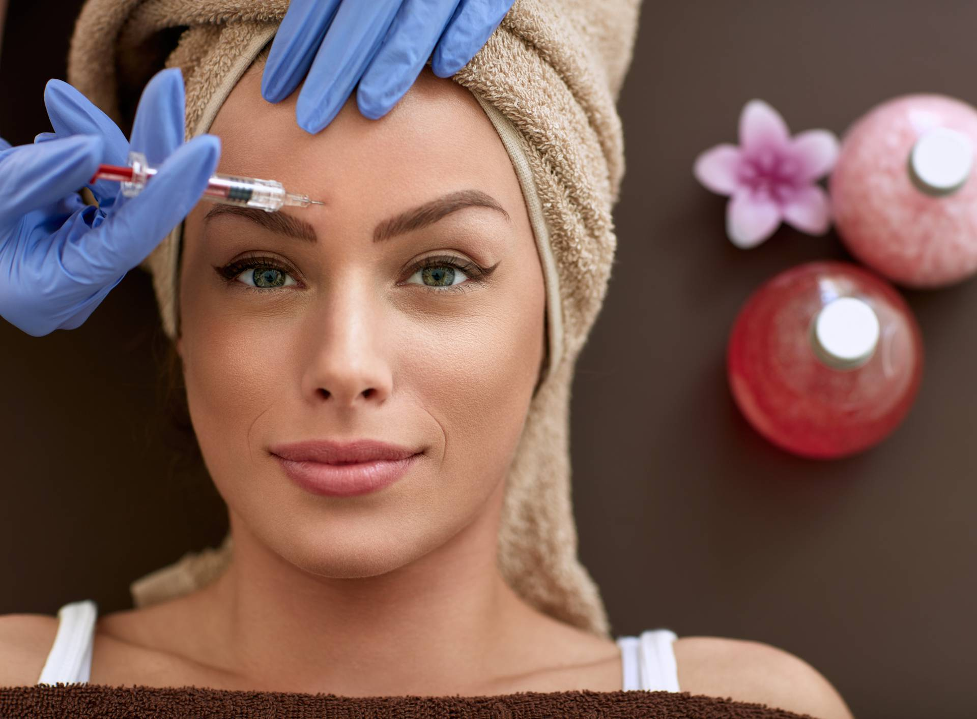 Beautiful woman receiving botox injections