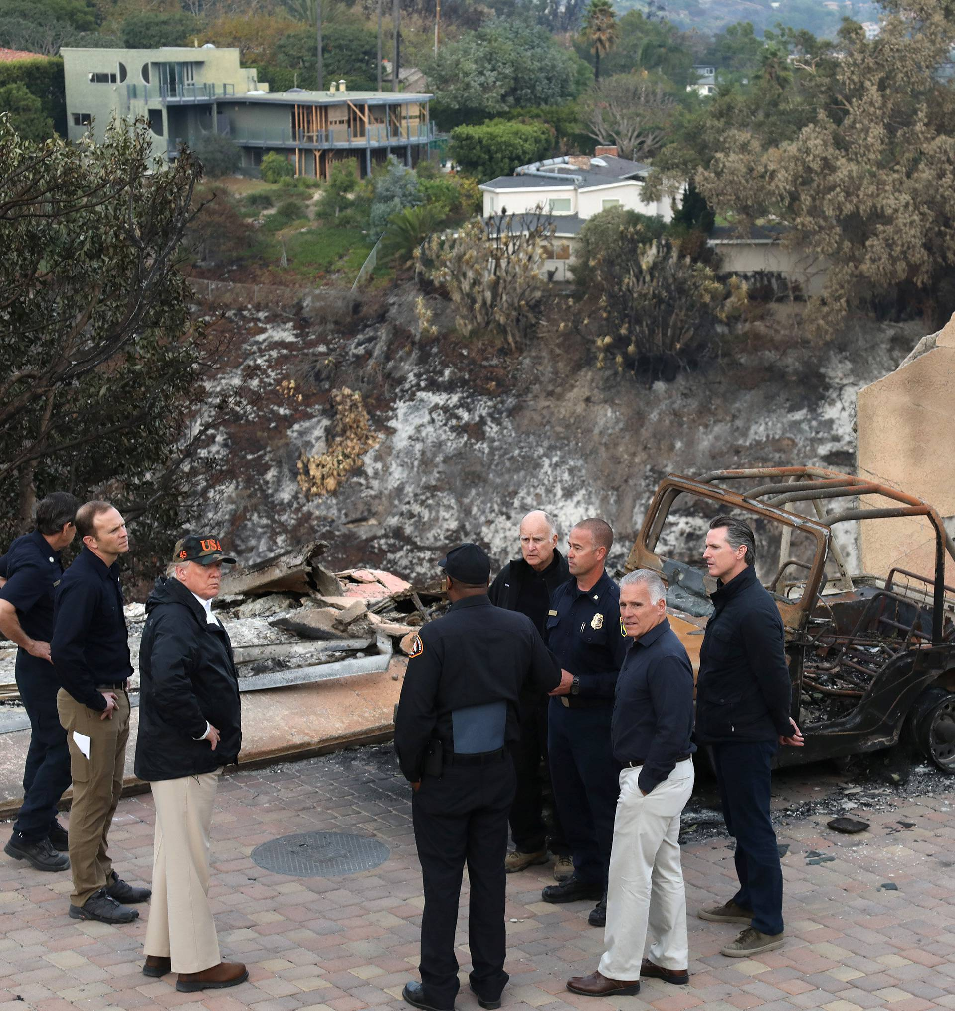 President Donald Trump surveys homes destroyed by the Woolsey fire in Malibu California