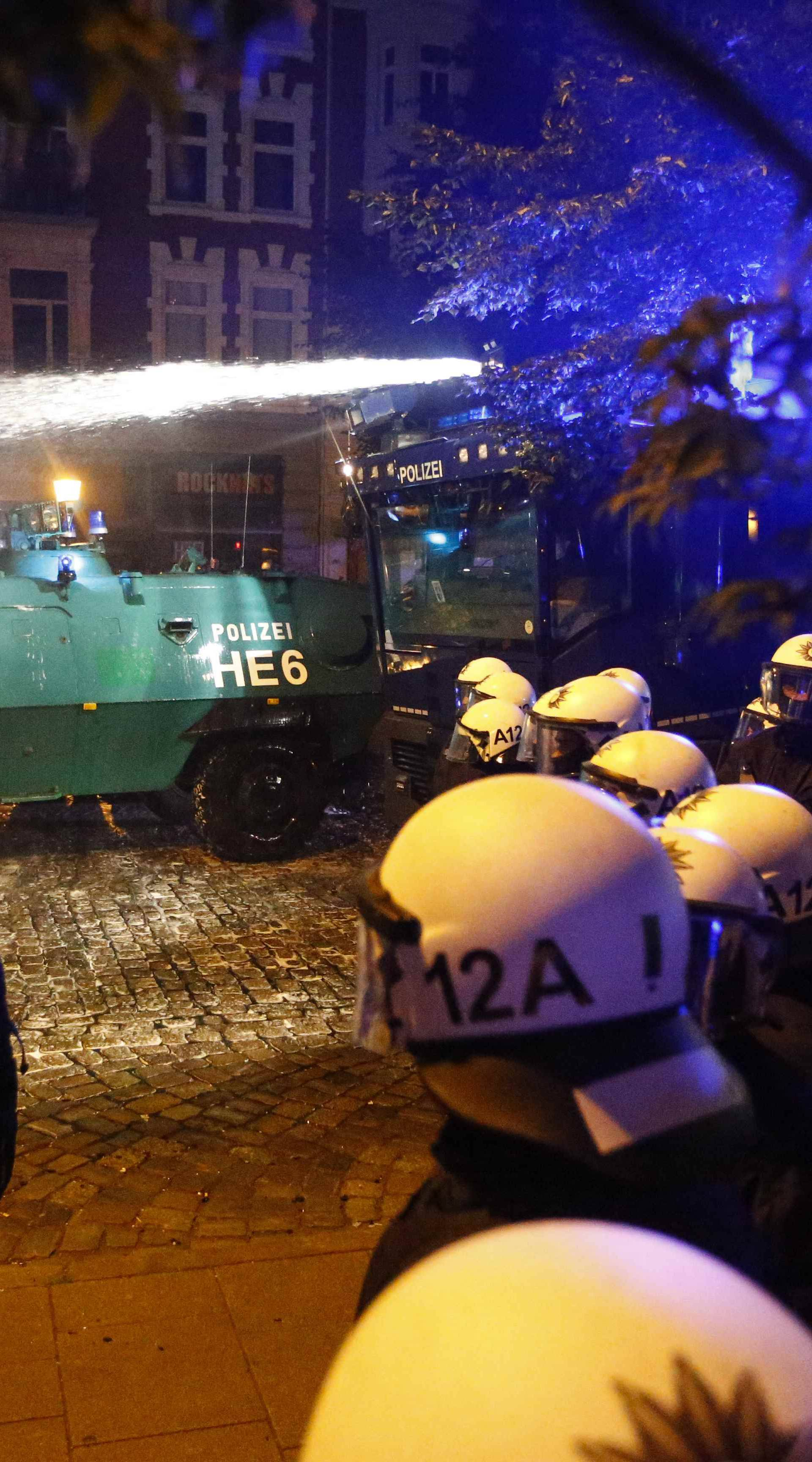 German riot police clash with protesters during the demonstrations during the G20 summit in Hamburg