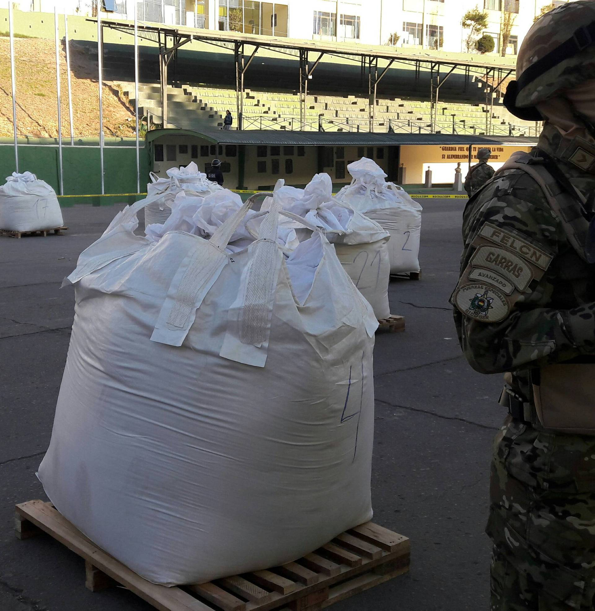 A member of Bolivian Special Force of Fight against traffic of Narcotics FELCN stands next to bags of Cocaine at the police headquarter in La Paz
