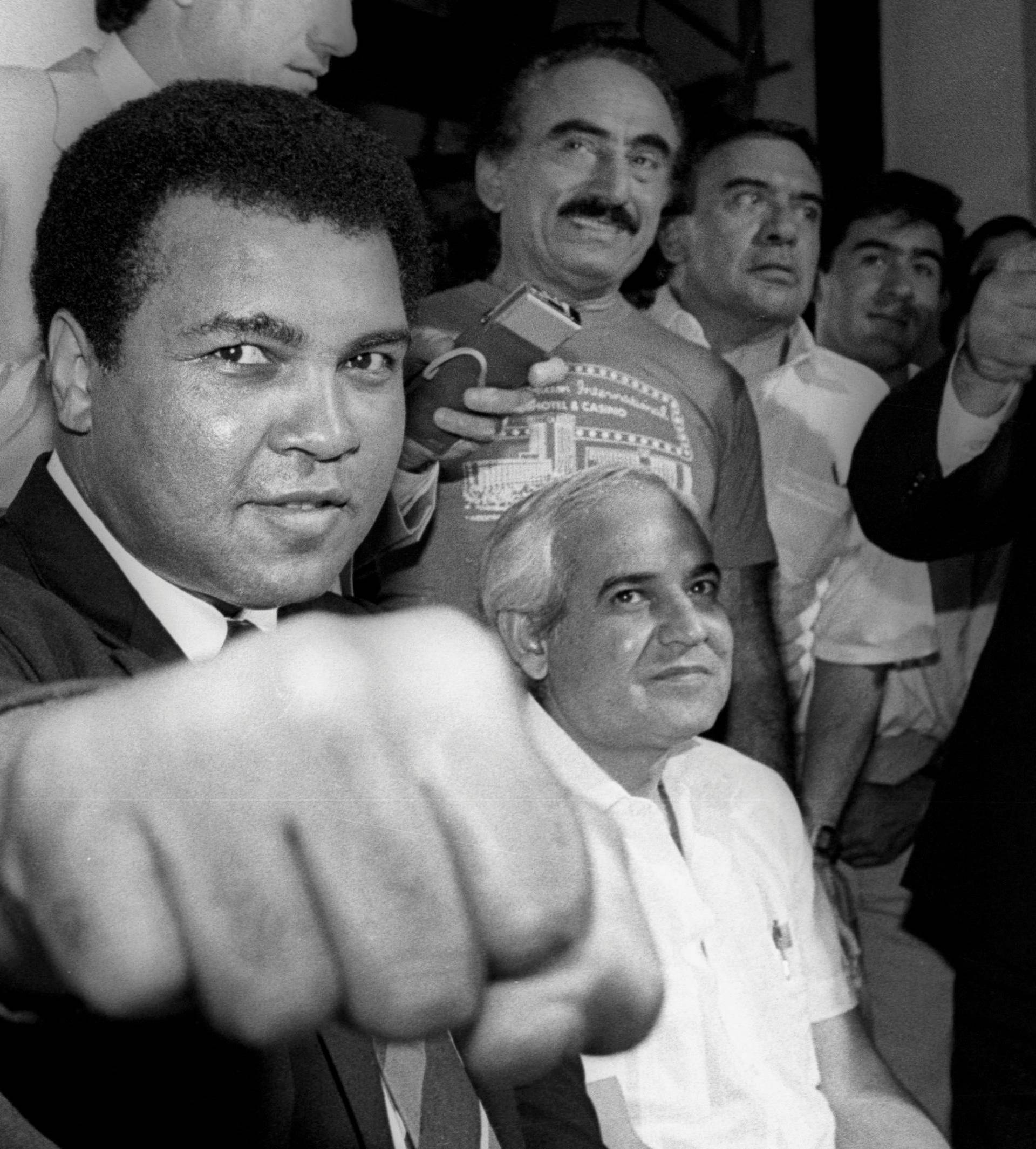 File photo of Muhammad Ali showing his fist to reporters during an impromptu news conference in Mexico City