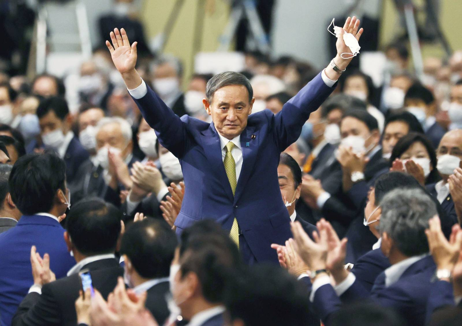 Japanese Chief Cabinet Secretary Suga gestures as he is elected as new head of the ruling party at the Liberal Democratic Party's (LDP) leadership election in Tokyo