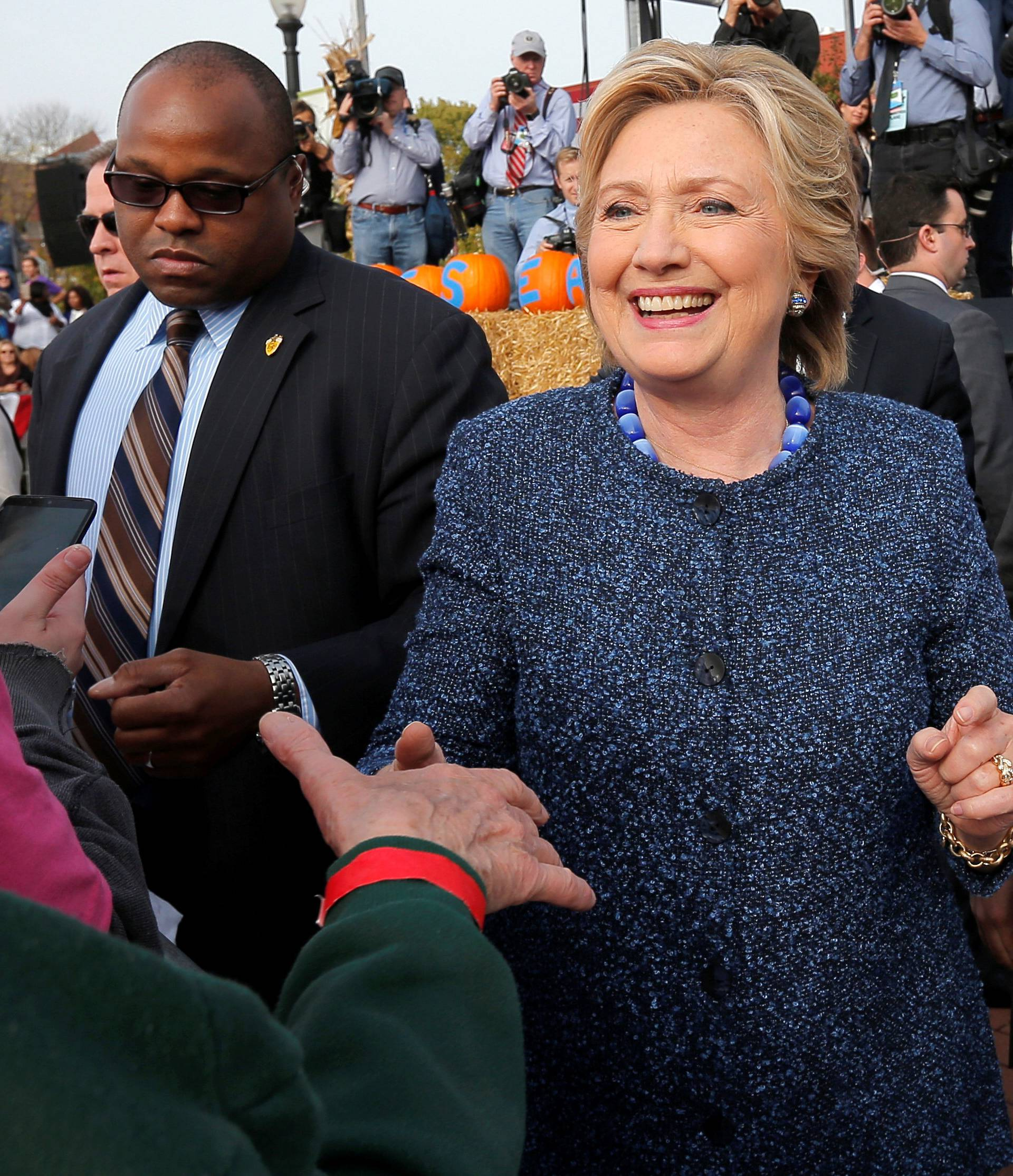 U.S. Democratic presidential nominee Hillary Clinton greets audience members at a campaign rally in Cedar Rapids