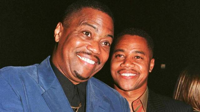 FILE PHOTO: Actor Cuba Gooding, Jr. poses with his father Cuba Gooding, Sr. as they arrive for the film's premiere in Beverly Hills