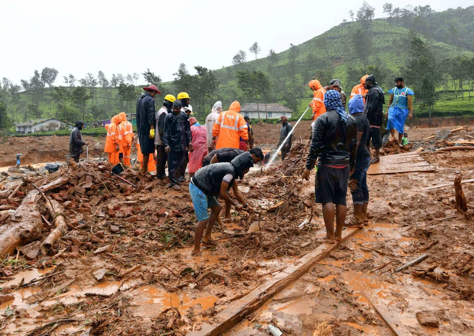 Rescuers remove debris as they search for victims of a landslide caused by torrential monsoon rains in Meppadi in Wayanad district