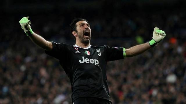 FILE PHOTO: Juventus goalkeeper Gianluigi Buffon celebrates their third goal scored by Blaise Matuidi in a 3-1 win against Real Madrid at the Santiago Bernabeu stadium, Madrid
