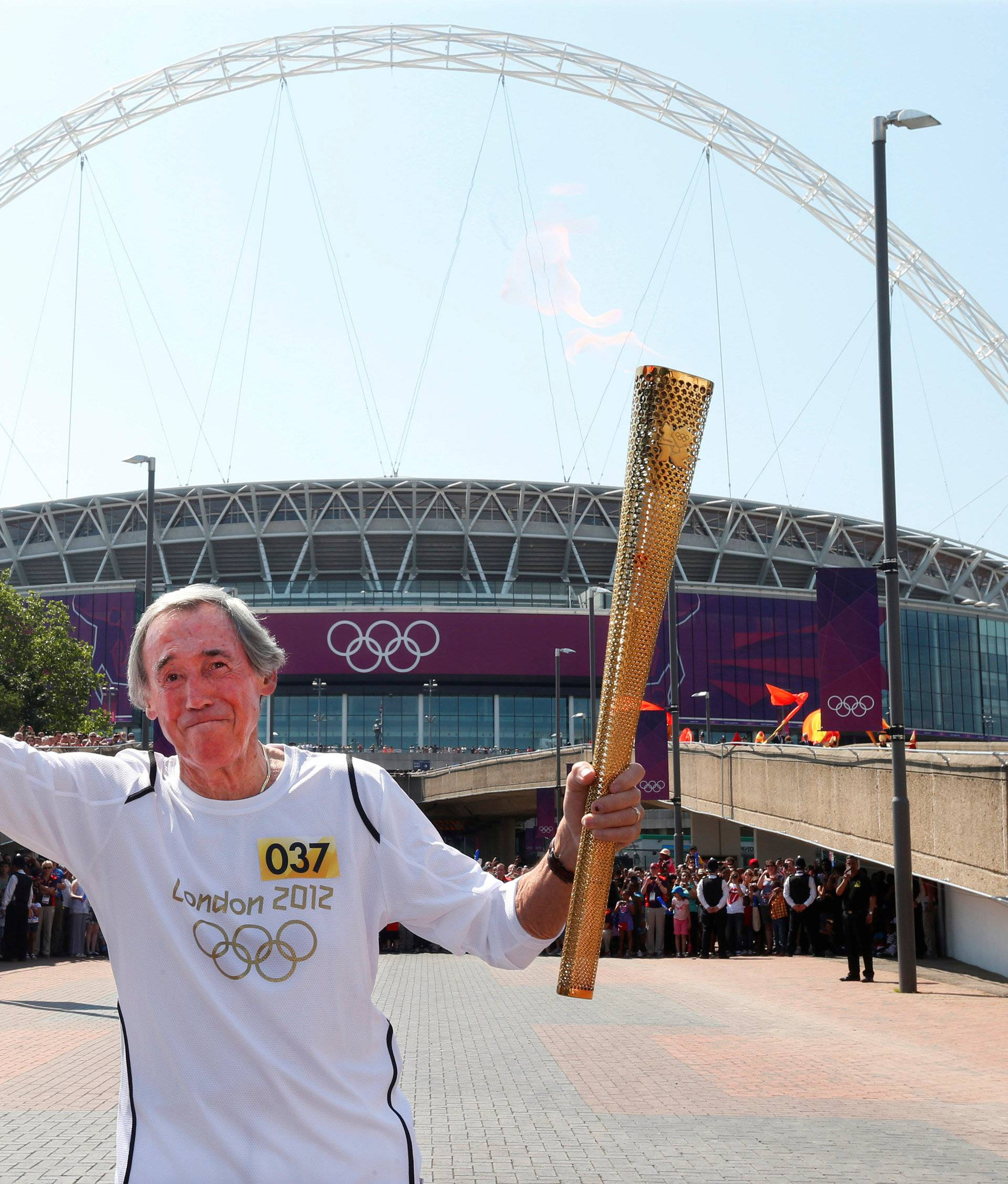 FILE PHOTO: British soccer player Banks runs with the London 2012 Olympic torch outside Wembley Stadium in northwest London