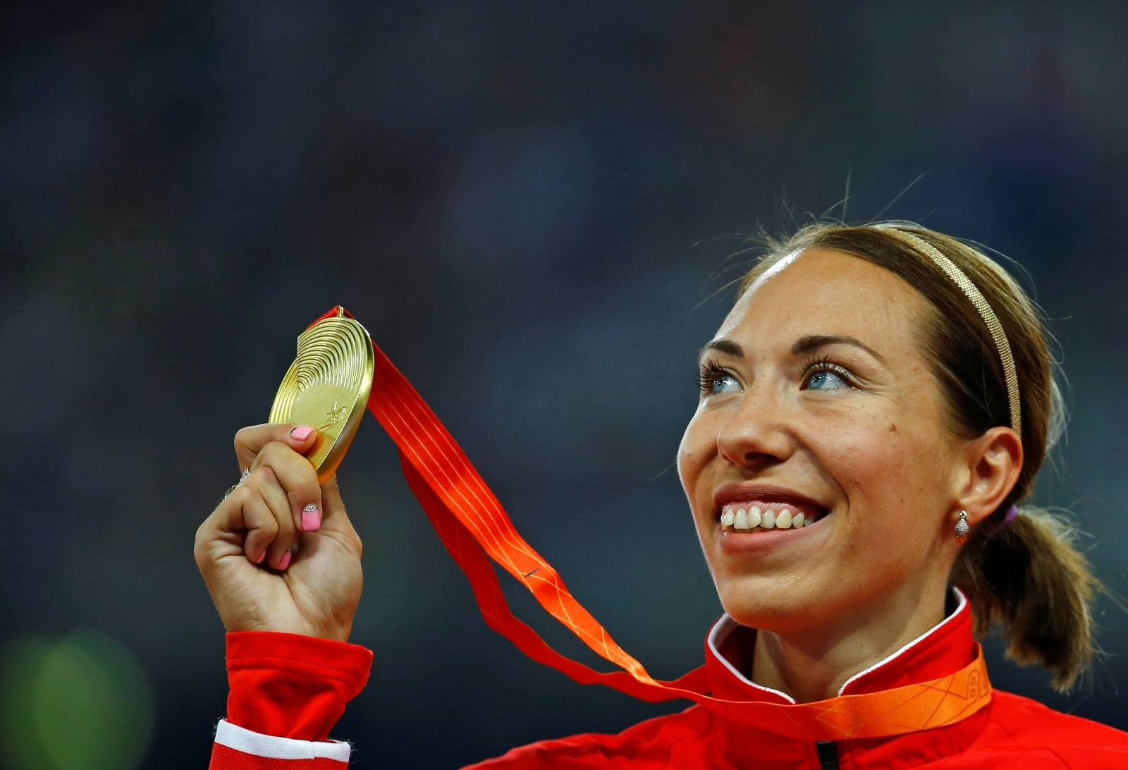 FILE PHOTO: Marina Arzamasova of Belarus holds up her gold medal as she poses on the podium after the women's 800m event during the during the 15th IAAF World Championships at the National Stadium in Beijing