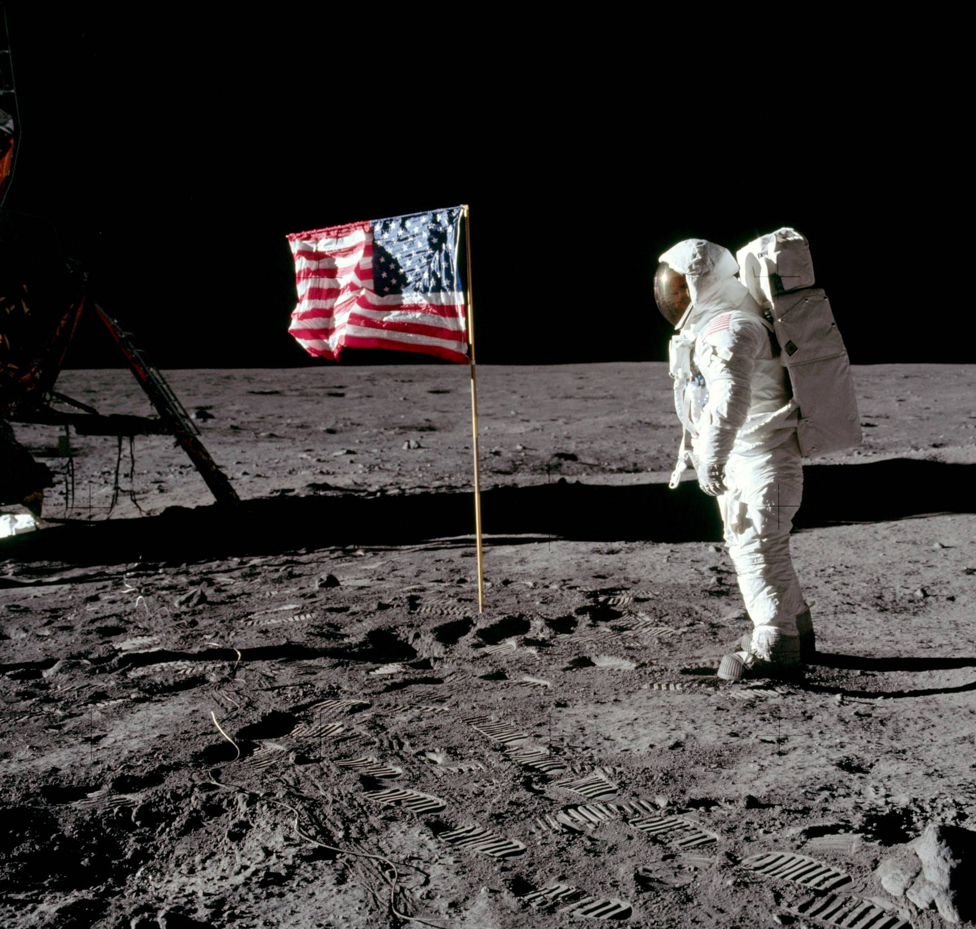 FILE PHOTO: Buzz Aldrin poses for a photograph beside the deployed United States flag on the moon